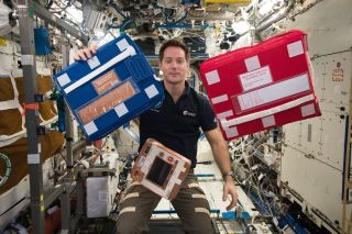 Thomas Pesquet with medical bags on ISS