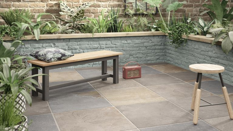 how to lay porcelain tiles outside: patio area with bench