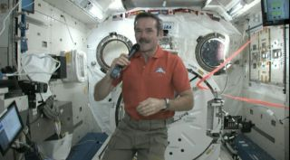 "Canadian astronaut Chris Hadfield speaks via phone with ""Star Trek"" actor William Shatner from the International Space Station on Feb. 7, 2013."