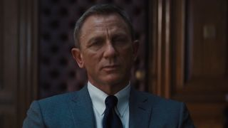 James Bond listening to M vent about his latest adversary Lyutsifer Safin's technology-based plan in the trailer for No Time to Die
