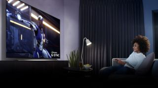 A woman plays games with FreeSync on her LG CX