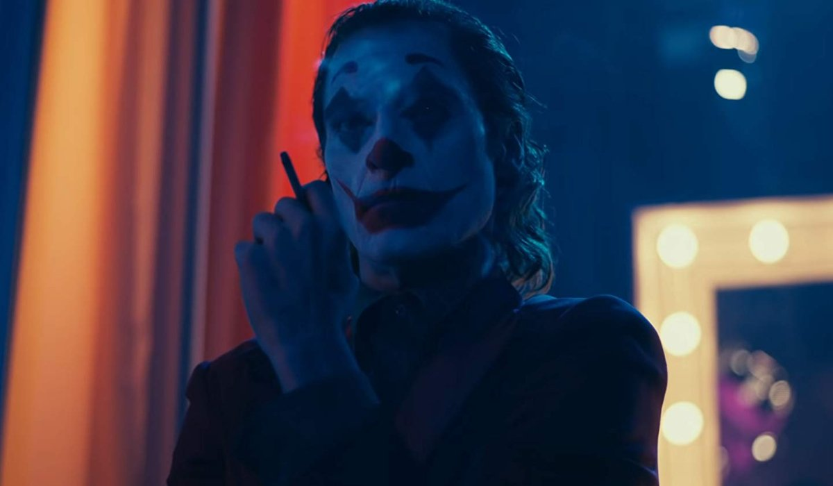 Joker smoking a cigarette backstage at Murray Hamilton's show