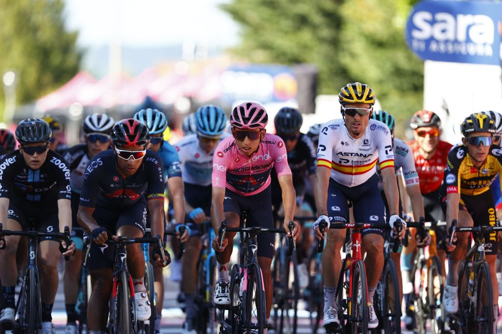 Overall leader Team Ineos rider Colombias Egan Bernal C and the pack cross the finish line of the twelfth stage of the Giro dItalia 2021 cycling race 212 km between Siena and Bagno di Romagna on May 20 2021 Photo by Luca Bettini AFP Photo by LUCA BETTINIAFP via Getty Images