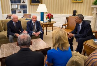 A press photo shows Obama with Michael Collins and Buzz Aldrin in the White House