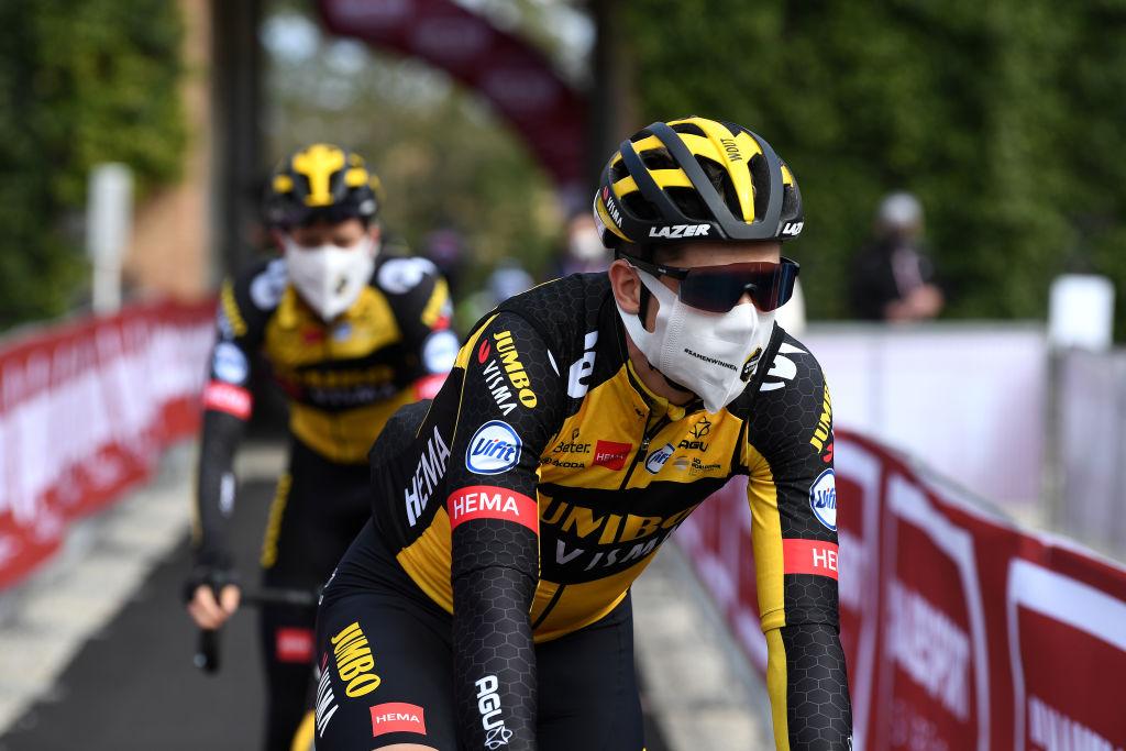 Wout van Aert rides to the start