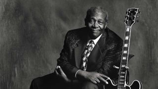 BB King posed with a guitar