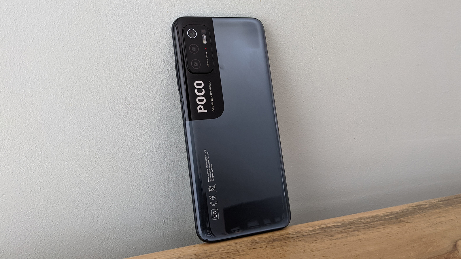 The Poco M3 Pro 5G from the back, on a table
