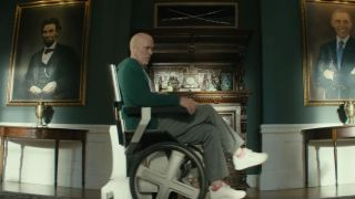 Wade Wilson (Ryan Reynolds) sitting on Professor X's chair, Cerebro, in Deadpool 2