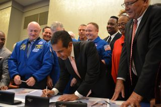Los Angeles mayor Antonio Villaraigosa signs the title transfer for space shuttle Endeavour during a ceremony at the California Science Museum on Oct. 11, 2011. Endeavour will be permanently displayed at the science center for the public to see after deli