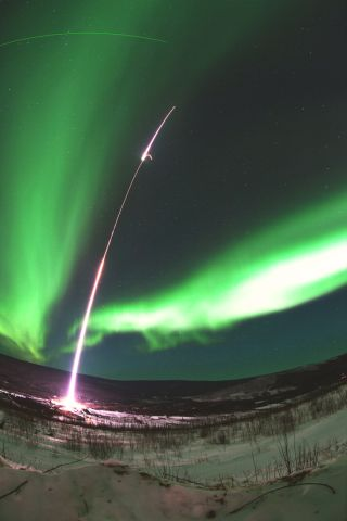 A two-stage Terrier-Black Brant rocket arced through aurora 200 miles above Earth as the Magnetosphere-Ionosphere Coupling in the Alfvén resonator (MICA) mission investigated the underlying physics of the northern lights. Stage one of the rocket has just
