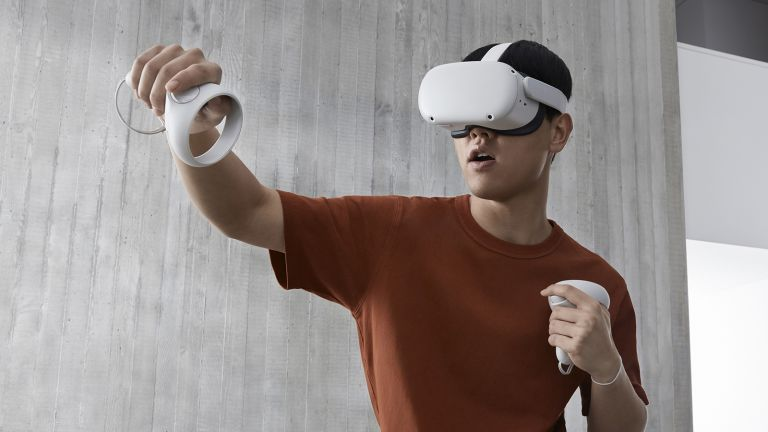 Best VR headset hero image showing man using Oculus Quest 2