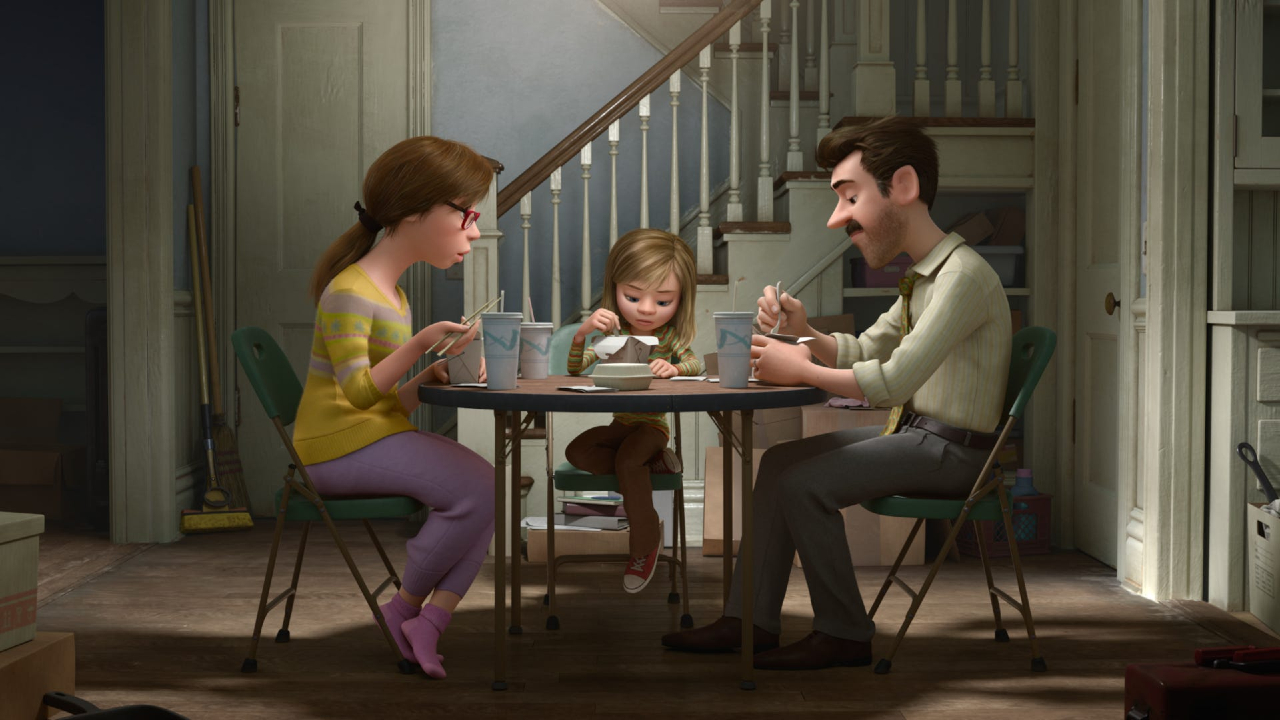 Riley and her parents sit at the dinner table in Inside Out