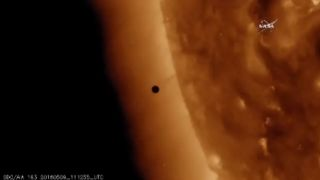 Dot of Mercury in front of the sun