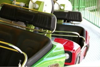 Bumper cars lined up at an amusement park.