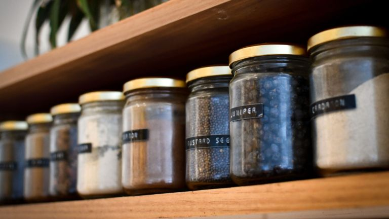 how to get rid of pantry moths - loose herbs in a pantry - heather-mckean-1I9bMlIAIBM-unsplash