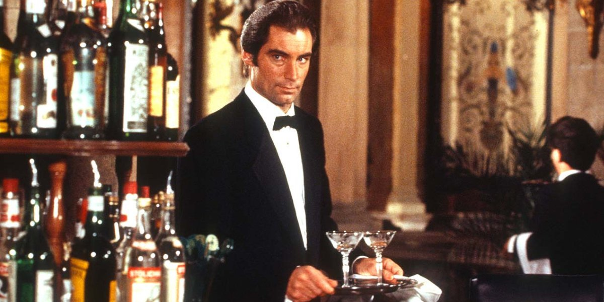 License to Kill Timothy Dalton carries a tray of drinks cautiously