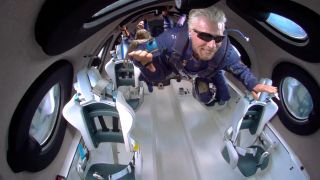 Virgin Galactic founder Richard Branson soars like Superman while in weightlessness during his spaceflight on Virgin Galactic's VSS Unity on July 11, 2021.