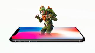 A photo illustration of a Fortnite: Battle Royale character in a dino-suit emerging from an iPhone X.