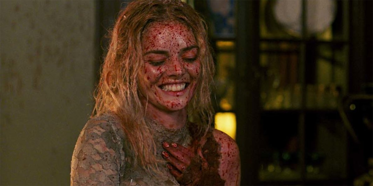 Samara Weaving laughing at the end of Ready Or Not