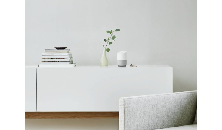 Google home on white sideboard
