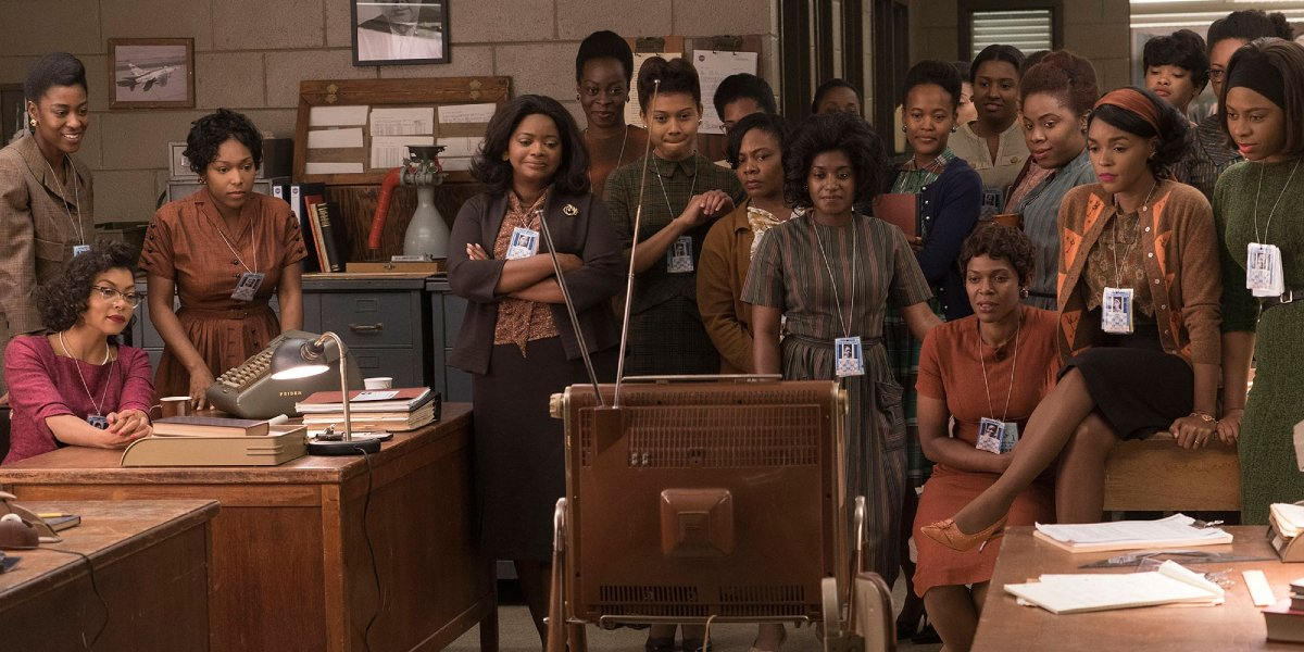 The female mathematicians watch as American astronauts go to space in Hidden Figures