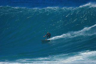 surfer rides a wav