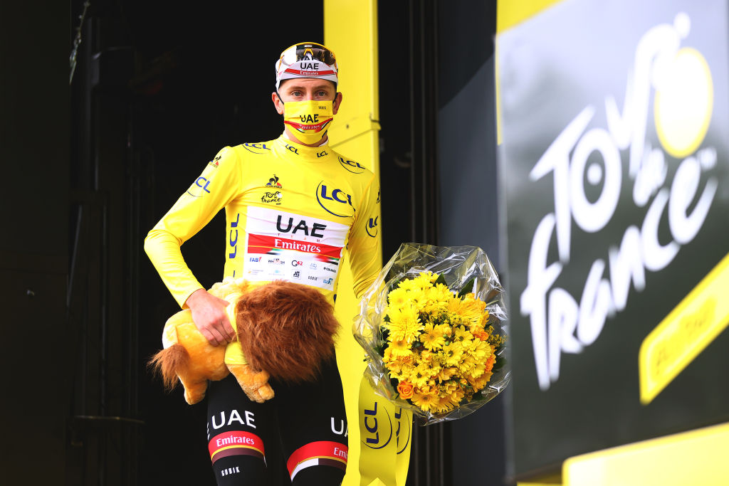 SAINTGAUDENS FRANCE JULY 13 Tadej Pogaar of Slovenia and UAETeam Emirates yellow leader jersey celebrates at podium during the 108th Tour de France 2021 Stage 16 a 169km stage from Pas de la Casa to SaintGaudens Lion Mascot LeTour TDF2021 on July 13 2021 in SaintGaudens France Photo by Michael SteeleGetty Images