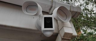 The Ring Floodlight Cam Pro Wired mounted on the exterior of a building