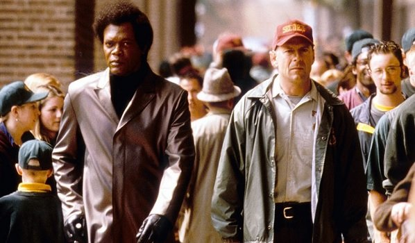 Unbreakable Samuel L. Jackson Bruce Willis Mr Glass and David walk through the crowd