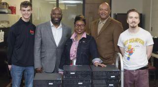 Maryville University staff donates tech equipment to Boys' & Girls' Club