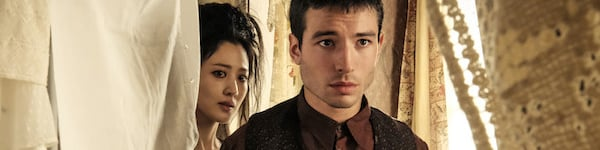 Claudia Kim and Ezra Miller as Nigini and Credence in Fantastic Beasts The Crimes of Grindelwald