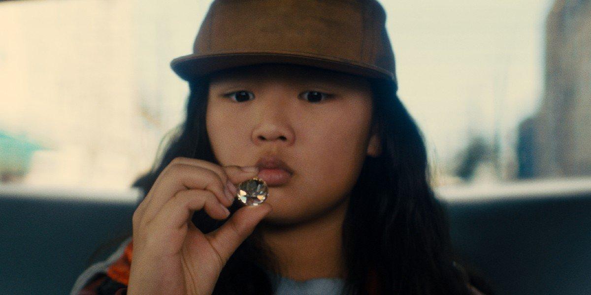 Cassandra Cain (Ella Jay Basco) looks at a diamond in Birds of Prey (2020)