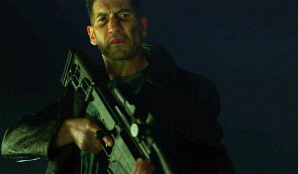 jon bernthal with large gun as The Punisher