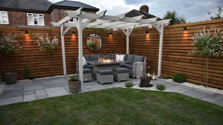 pergola with outdoor sofa in a back garden