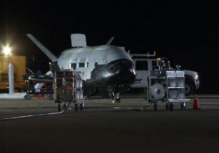 The U.S. Air Force's secretive X-37B robot space plane landed at Vandenberg Air Force Base in California on Dec. 3, 2010 to end a successful — but mysterious — seven month mission that was shrouded in secrecy. Recovery crews were quick on scene to meet th