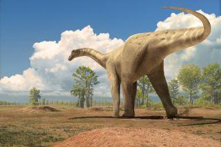 A large dinosaur walking a dusty landscape.