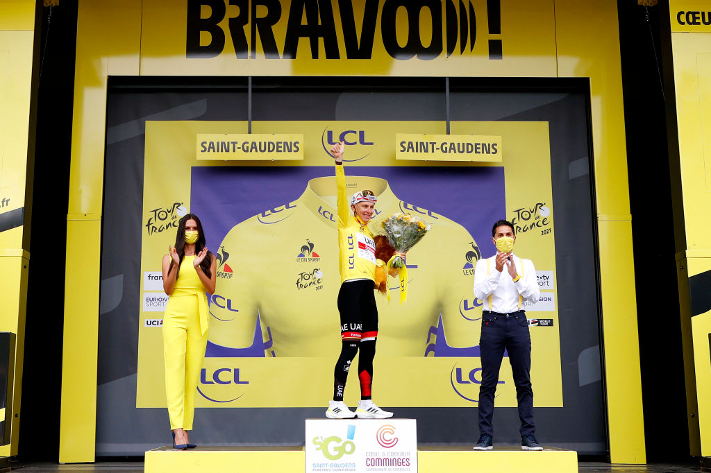 SAINTGAUDENS FRANCE JULY 13 Tadej Pogaar of Slovenia and UAETeam Emirates yellow leader jersey celebrates at podium during the 108th Tour de France 2021 Stage 16 a 169km stage from Pas de la Casa to SaintGaudens Lion Mascot LeTour TDF2021 on July 13 2021 in SaintGaudens France Photo by Chris GraythenGetty Images