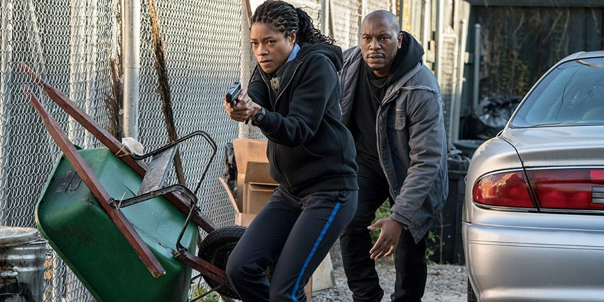 Black And Blue Naomie Harris and Tyrese Gibson sneak along a chain link fence