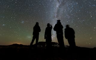 Four members of the New Horizons' South African observation team