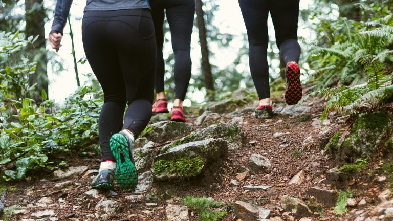 women running on a trail to lose weight from your thighs