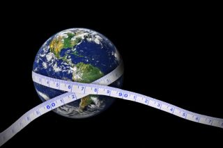Measuring tape wrapped around the Earth (photo of Earth from NASA)
