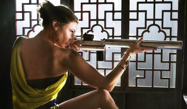 Rebecca Ferguson Isla Faust Mission Impossible aiming gun
