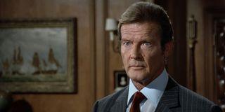 Roger Moore looking intense as James Bond.