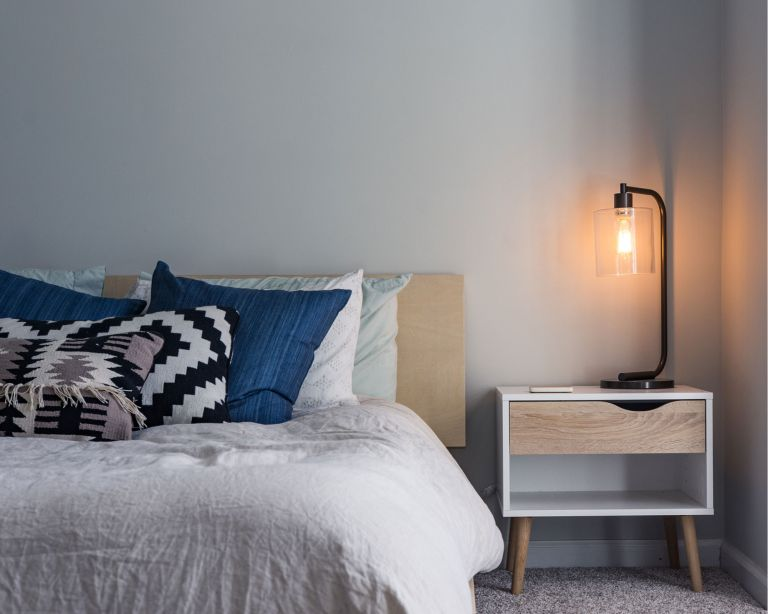 men's bedroom ideas – blue and grey bedroom with bedside lamp
