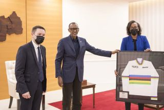 The Rwanda president Paul Kagame with UCI president David Lappartient and the UCI Director General Amina Lanaya