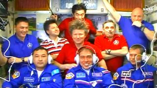 Nine Crewmembers Aboard the Space Station