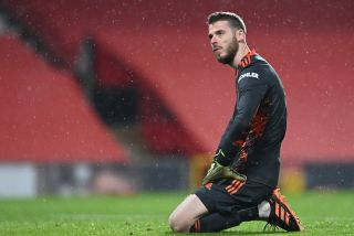 Manchester United goalkeeper David de Gea appears dejected after they concede a second goal during the Premier League match at Old Trafford, Manchester.