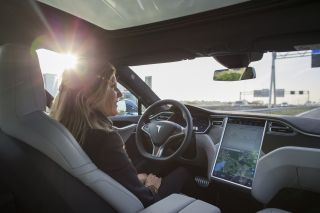 An employee drives a Tesla Motors Inc. Model S electric automobile, equipped with Autopilot hardware and software, hands-free on a highway in Amsterdam, Netherlands, on Monday, Oct. 26, 2015.