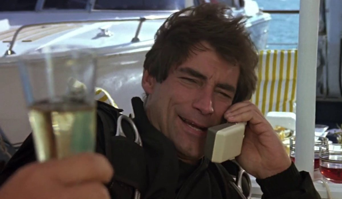 The Living Daylights Timothy Dalton being offered a glass of champagne