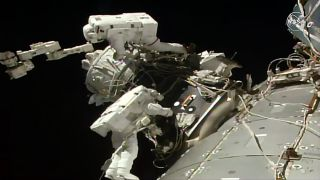 Astronauts Nick Hague and Andrew Morgan install IDA-3 outside the International Space Station on Wednesday, August 21.